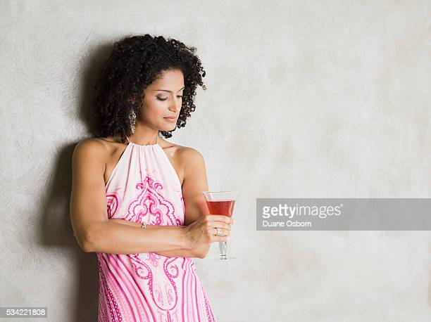 woman with a cocktail - halter neck stock pictures, royalty-free photos & images