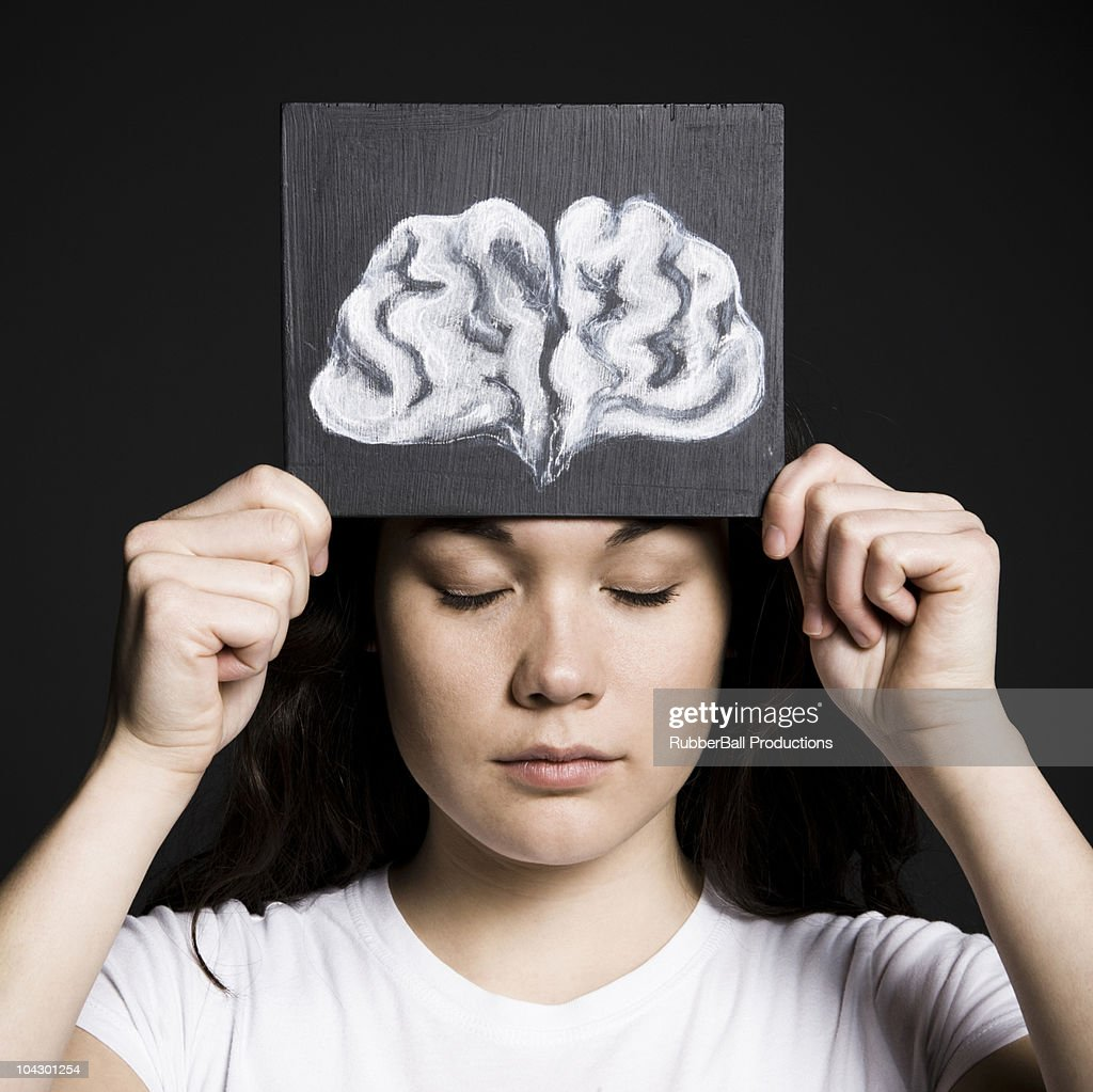 Woman with a drawing of a brain : Stock Photo