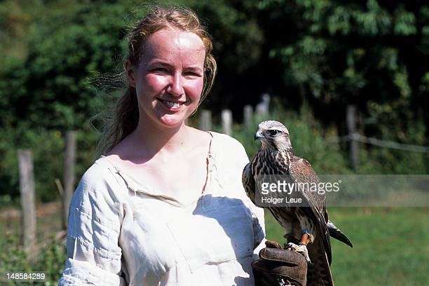 Woman with a falcon for a falconry demonstration at the Ribe Vikingecenter.