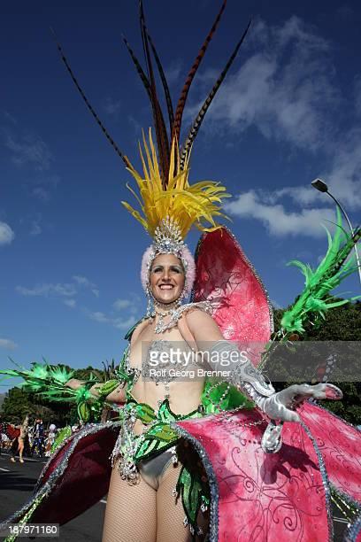 CONTENT] A woman with a fantasy costume at the carnival parade in Santa Cruz de Tenerife