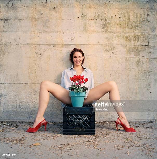 Woman With a Flower Pot Between Her Legs