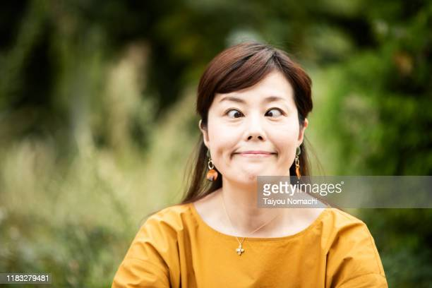 woman with a funny face - gagged woman stock pictures, royalty-free photos & images