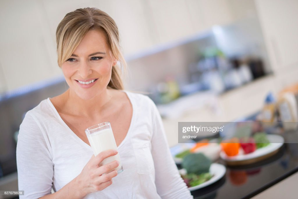Woman with a glass of milk : Stock Photo
