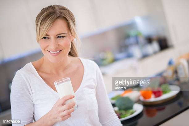 woman with a glass of milk - osteoporosis stock pictures, royalty-free photos & images