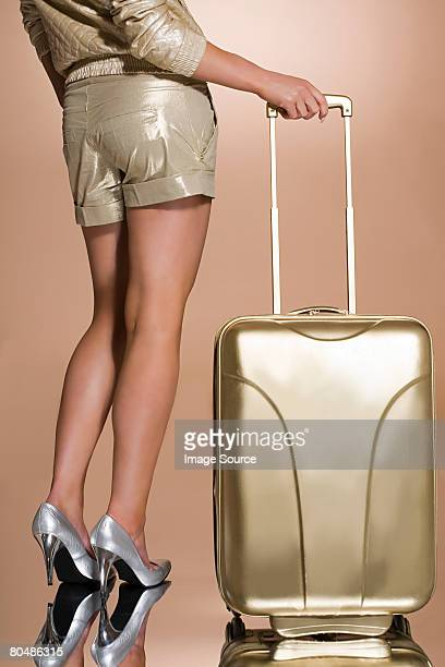 Woman with a golden suitcase
