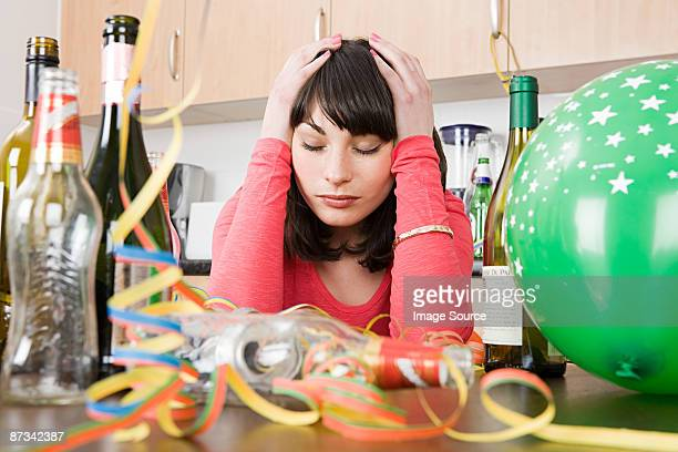 Woman with a hangover after a party