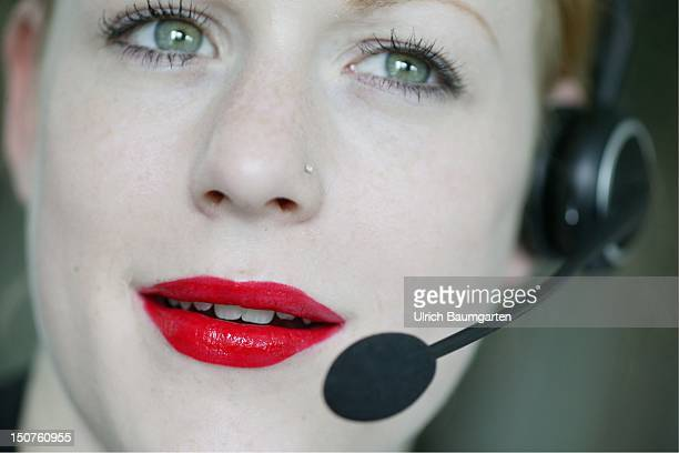 GERMANY Woman with a headset callcenter employee