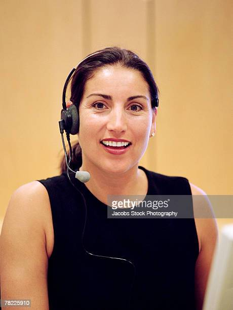 woman with a headset - volume fluid capacity stock pictures, royalty-free photos & images