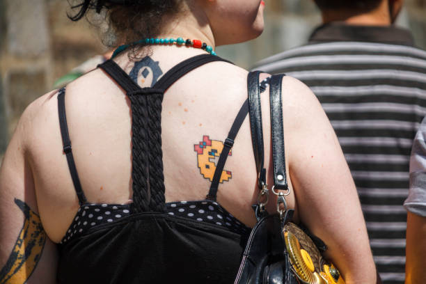 A woman with a lady pacman tattoo on her back