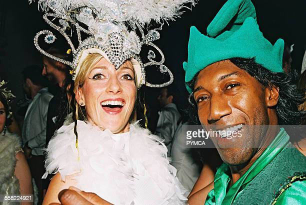 A woman with a large headdress and a man dressed as an elf laugh at Return to Narnia Pushca New Years Eve 2004