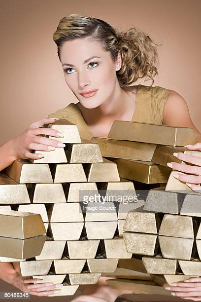 Woman with a large stack of gold