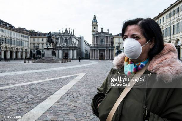A woman with a mask in Piazza San Carlo in Turin during on the Italy Continues Nationwide Lockdown To Control Coronavirus Spread on March 16 2020 in...