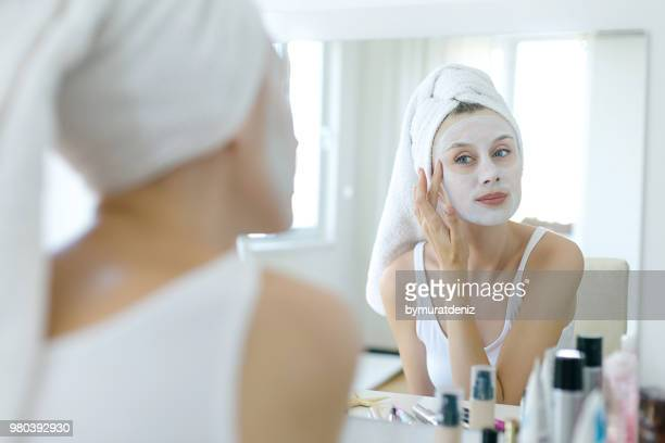 woman with a mask on her face - face masks imagens e fotografias de stock