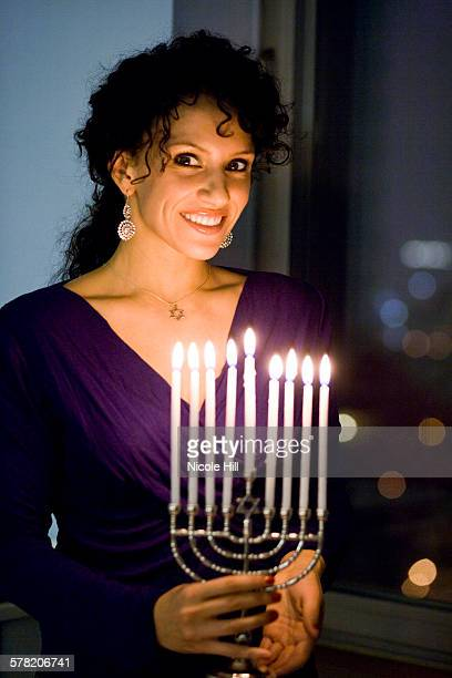 woman with a menorah - hannukkah stock pictures, royalty-free photos & images