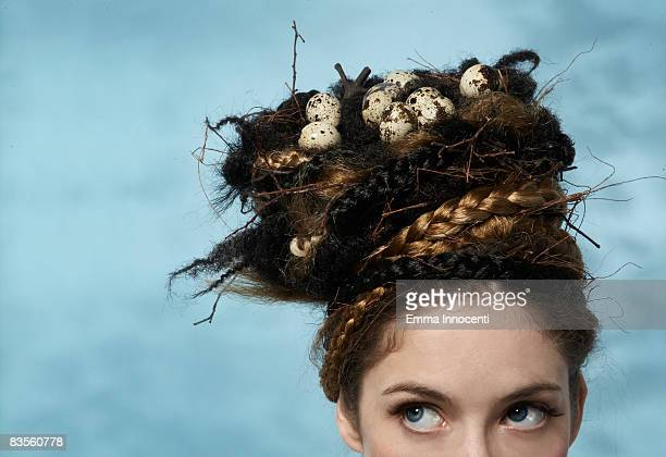 Woman with a nest on her head