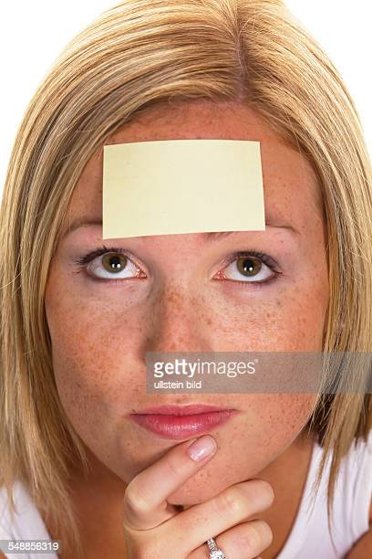 woman with a notepad on her forehead