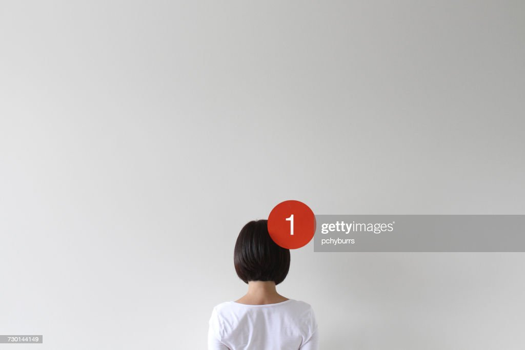 Woman with a notification icon : Stock Photo