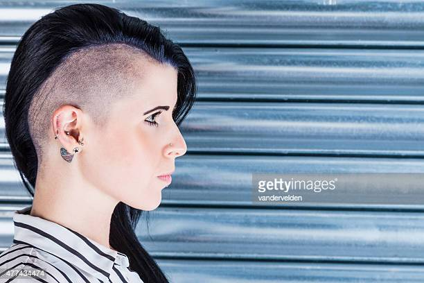 woman with a part-shaved head and tattoos - shaved head stock pictures, royalty-free photos & images