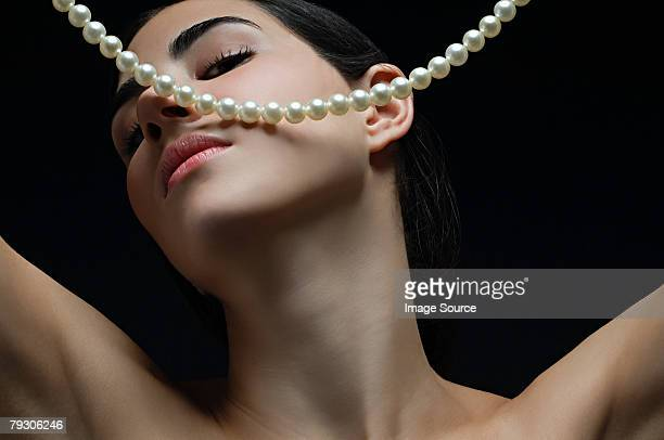 woman with a pearl necklace - pearl necklace stock pictures, royalty-free photos & images