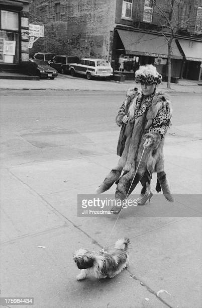 A woman with a penchant for fur walks her dog on West Broadway New York between Houston and Prince Street 1988