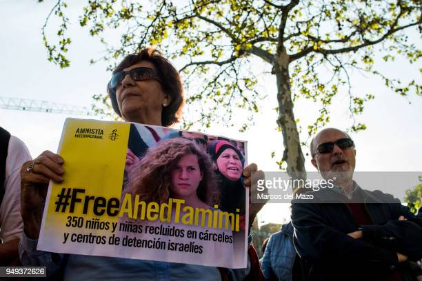 A woman with a placard demanding freedom for Ahed Tamimi during a protest in front of the Israeli embassy against war in Palestine and Syria
