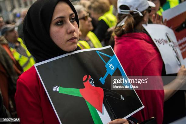 A woman with a placard protesting against the last deaths in Gaza Strip coinciding with the Nakba Day Palestinians showed solidarity the day after...