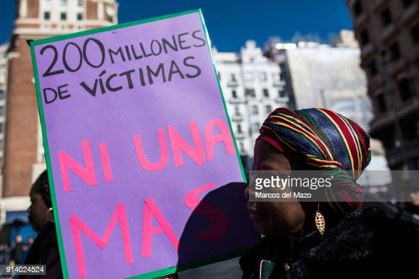 A woman with a placard that reads 200 million victims no one more protesting against female genital mutilation