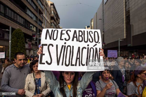 """Woman with a placard that reads """"it is not abuse, it is rape"""" during a demonstration against the verdict of """"La Manada"""" case. The Court of Navarra..."""