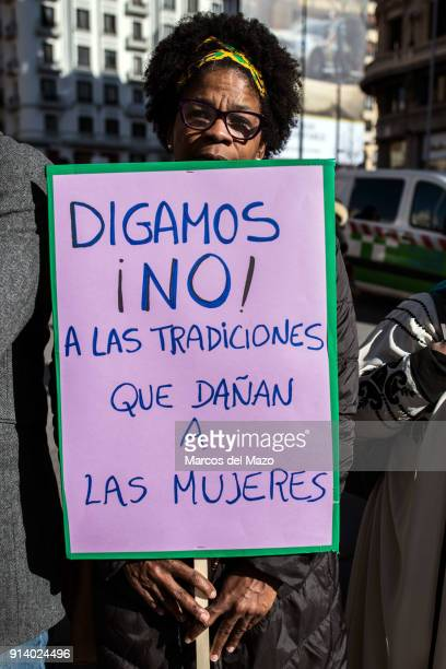 A woman with a placard that reads Let's say no to traditions that harm women protesting against female genital mutilation