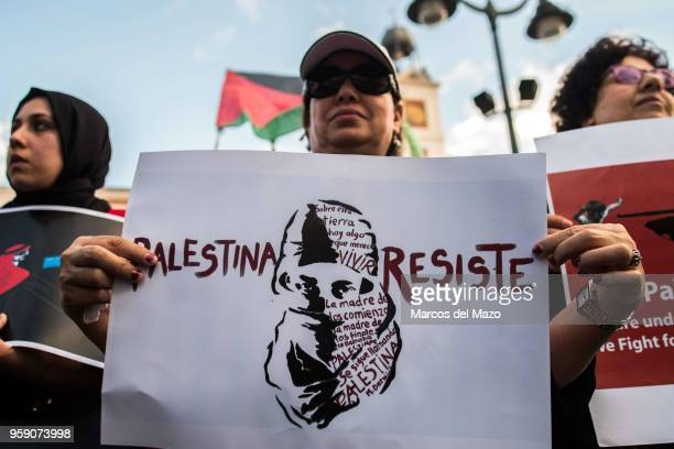"""Woman with a placard that reads """"Palestine resist"""" protesting against the last deaths in Gaza Strip coinciding with the Nakba Day. Palestinians..."""