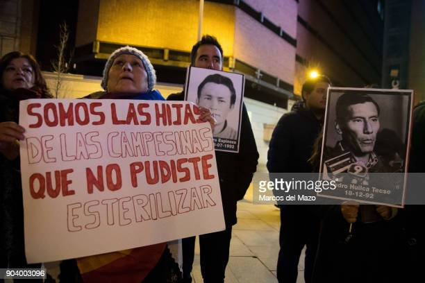 """Woman with a placard that reads """"We are the daughters that you could not sterilize"""" during a protest against the pardon for Peruvian President..."""