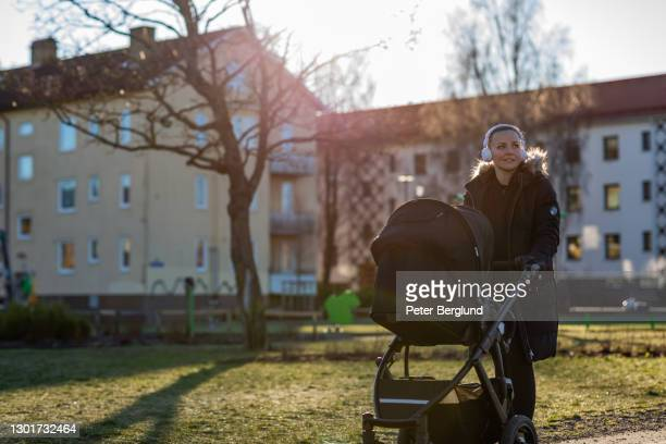 woman with a pram in a park - carriage stock pictures, royalty-free photos & images