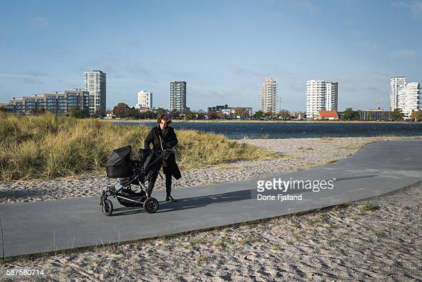woman with a pram - dorte fjalland photos et images de collection