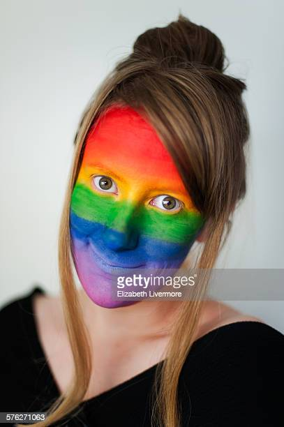 woman with a rainbow face - body paint stock pictures, royalty-free photos & images
