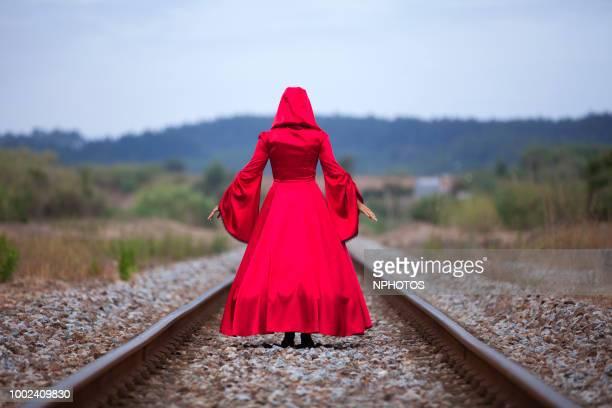 woman with a red dress - kopfbedeckung stock-fotos und bilder