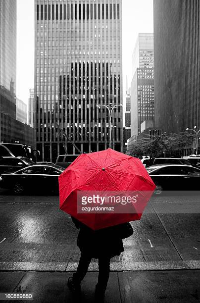 Woman with a red umbrella in New York City