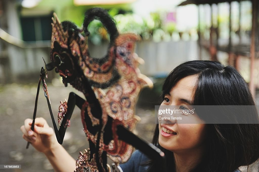 Woman with a shadow puppet : Stock Photo