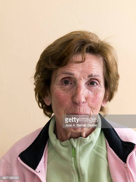 woman with a slight smile and face of coyness - pants down woman stock pictures, royalty-free photos & images