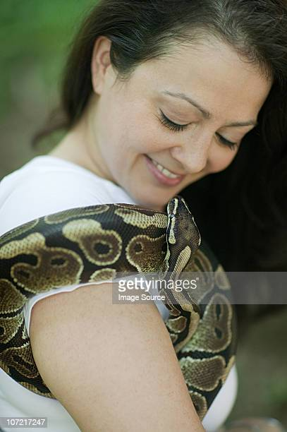 woman with a snake - exotic pets stock pictures, royalty-free photos & images