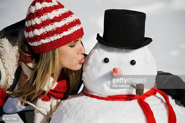 A woman with a snowman