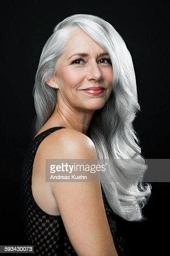 Woman With A Soft Smile And Long Gray Hair Stock Photo