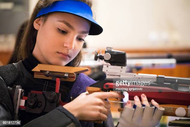 woman with a sporting gun ready to shoot - taking a shot sport stock pictures, royalty-free photos & images