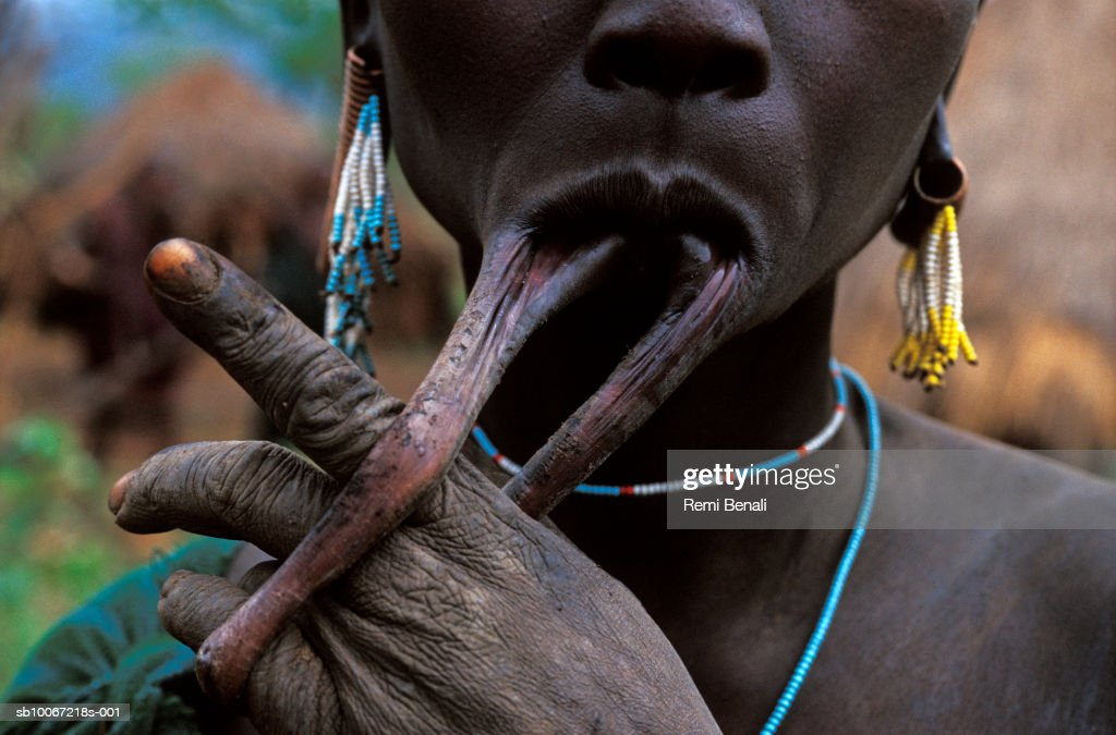 Ethiopia, Omo Valley, Surma tribe woman with stretched lip from lip plate, close-up : News Photo