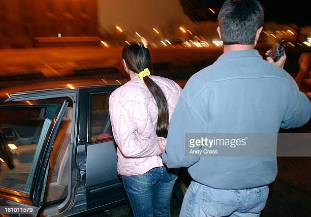 COJANUARY 11TH 2005A woman with a street name of 'Desire' <cq> from Kanas is escorted to an unmarked police car by a Denver Vice cop after being...