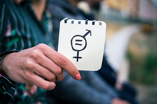 woman with a symbol for gender equality 919017892