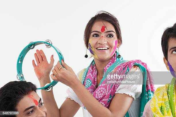 woman with a tambourine - tambourine stock photos and pictures