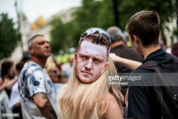 A woman with a Tommy Robinson mask Protesters are calling for the release of English Defense League leader Tommy Robinson who is serving 13 months in...