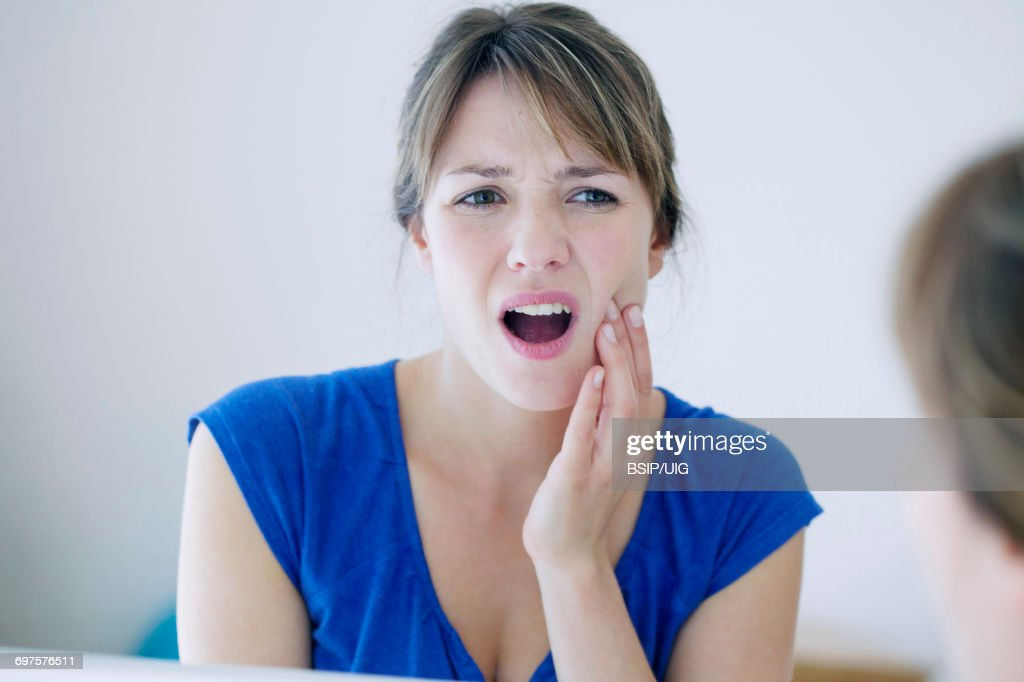 Woman with a toothache : Stock Photo