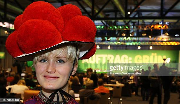 A woman with a traditional Bollenhut poses at the Greens Party national convention on November 21 2010 in Freiburg Germany The German Greens have...