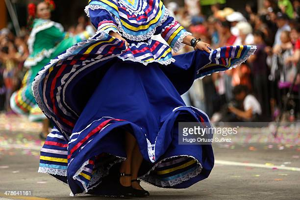 Woman with a typical regional dress dancing with its colorful Mexican dress parade during the International Mariachi XX and Charreria in Guadalajara,...